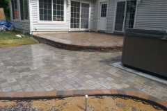 Raised Paver Patio and Hot Tub installed in New Hampshire By Natures Elite Landscaping Gilford New Hampshire, Belknap County