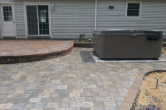 Raised Paver Patio with Hot Tub, installed by Natures Elite Landscaping New Hampshire